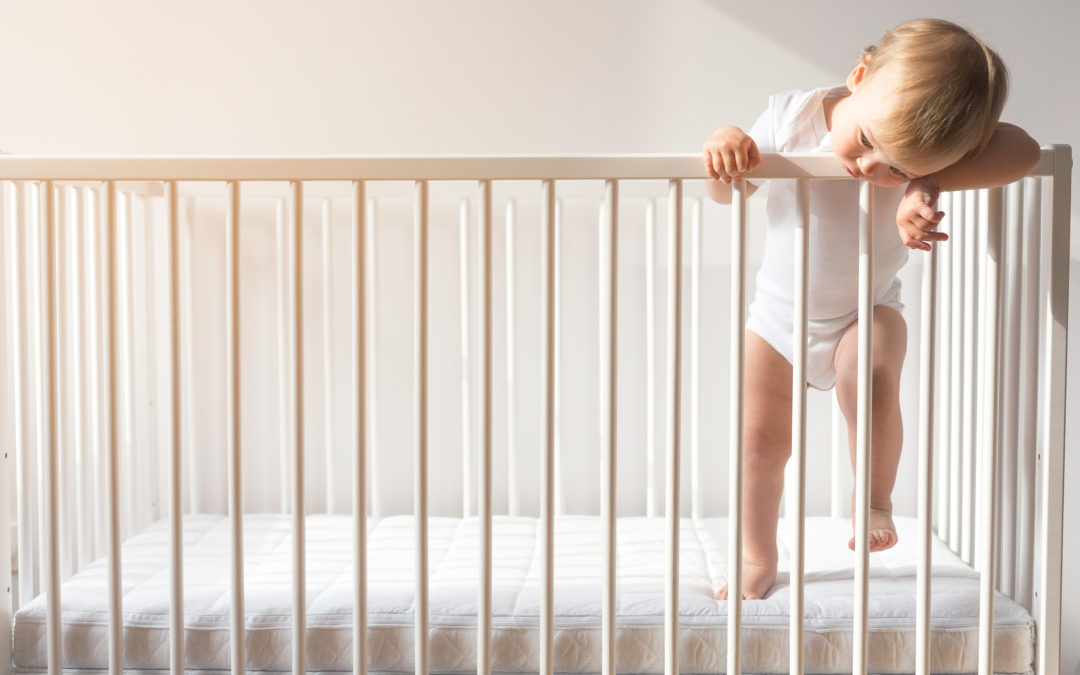 baby climbing out of crib | Long Island NY Sleep Consultant | Sleep Rest and Play